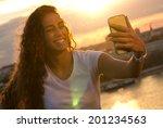 beautiful girl taken pictures... | Shutterstock . vector #201234563