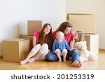 happy young family sitting on a ... | Shutterstock . vector #201253319