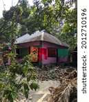 Small photo of Dhaka, Bangladesh - October 25 2020: A village house with tine roof in a village landscape