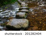 Stepping Stones Over River And...