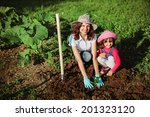 family in the garden. | Shutterstock . vector #201323120