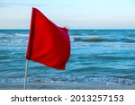 Red Warning Flag On The Beach...