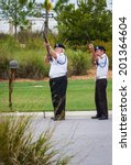Small photo of Sarasota, Florida - June 02 : American Legion, Honor Guard performing a full service military funeral; June 02 2014 in Sarasota VA National Cemetery in Florida