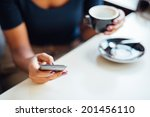 Young Black Woman Using Phone...
