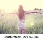 girl in a dress standing in a...   Shutterstock . vector #201468803