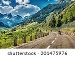Group of bikers touring European Alps, motorcyclists on mountainous road, enjoying ride, summertime activities, wonderful mountain landscape, extreme activities, freedom vacation concept  - stock photo
