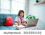 Small photo of first grade school student with uniform during online class study with teacher at home
