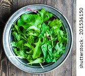 green salad on rustic background | Shutterstock . vector #201536150