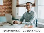 asian businessman in an office... | Shutterstock . vector #2015457179