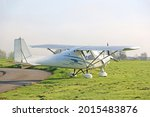 Ultralight Airplane On A Grass...