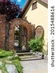 Brick Arch With Wrought Iron...