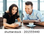couple enjoying a coffee and... | Shutterstock . vector #201555440
