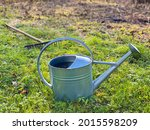 Metal Watering Can On Grass....