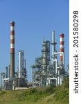 Small photo of Oil refinery, Europe. Polluting energy. Symbology with stop sign. Vertical shoot