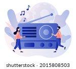 retro old radio. tiny people... | Shutterstock .eps vector #2015808503