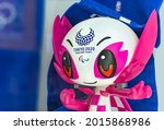 Small photo of tokyo, japan - july 20 2021: Closeup on the face of a plastic figurine depicting the cute and kawaii official mascot character someity adorned with the Tokyo 2020 Paralympic Games logo.