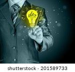 business man touching light of... | Shutterstock . vector #201589733