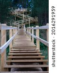 Long wooden stairs in forest. High quality photo