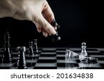 hand to manipulate chess pieces | Shutterstock . vector #201634838