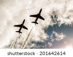 Two Fighter Jets Fly In The...
