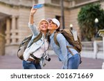 happy female tourists taking a... | Shutterstock . vector #201671669