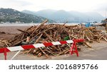 Small photo of Europe, Italy, Como, July 2021 extensive damage after the flood in Como - Lake Como is full of woods and trees undermined by the force of the storm due to rain and overflowing rivers
