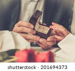 Man Holding Box With Ring...
