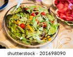 greek salad in plate on table | Shutterstock . vector #201698090