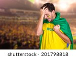 Small photo of Brazilian soccer fan or supporter crying in the championship or competition or cup.
