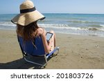 girl on the beach with ebook... | Shutterstock . vector #201803726