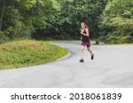woman running in the woods....   Shutterstock . vector #2018061839