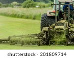 A Tractor Being Used To Cut...