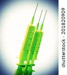 Three Disposable Syringes Gree...