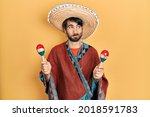 Young Hispanic Man Wearing...