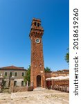 Ancient Civic Tower or Clock Tower in Murano island in medieval style. Campo Santo Stefano (Saint Stephen square), Venice, UNESCO world heritage site, Veneto, Italy, Europe.