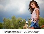 sexy woman with vintage bike in ... | Shutterstock . vector #201900004