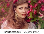 beautiful lady in the flowers... | Shutterstock . vector #201911914