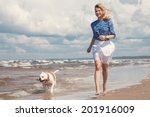 Stock photo happy young woman walking with dog 201916009