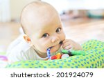 baby with toy in mouth | Shutterstock . vector #201924079
