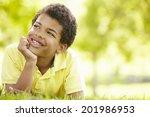 boy in park portrait | Shutterstock . vector #201986953