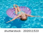 little girl lying on the ... | Shutterstock . vector #202011523