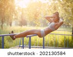 beautiful fitness woman doing... | Shutterstock . vector #202130584