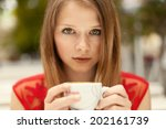 woman drinking coffee in the... | Shutterstock . vector #202161739