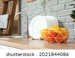 Plate With Fruits Near Sink In...