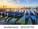 Venice With Famous Gondolas At...