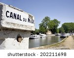 Southern France, Canal de Midi at the village of Capestang. Focused at the sign with the name of the canal. - stock photo