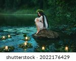 Slavic Girl Sits On Stone On...