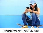 Woman Skateboarder Listening...