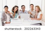 casual business team smiling at ... | Shutterstock . vector #202263343