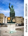 Small photo of Rome, Italy. Ancient statue of Octavian Augustus (Ancient Rome first emperor) in front the remains Forum of Caesar.